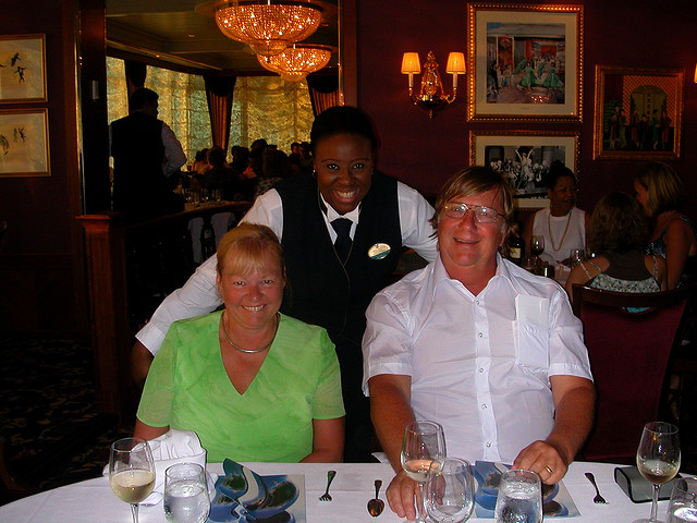 Mom and Dad on a cruise with our assistant waiter